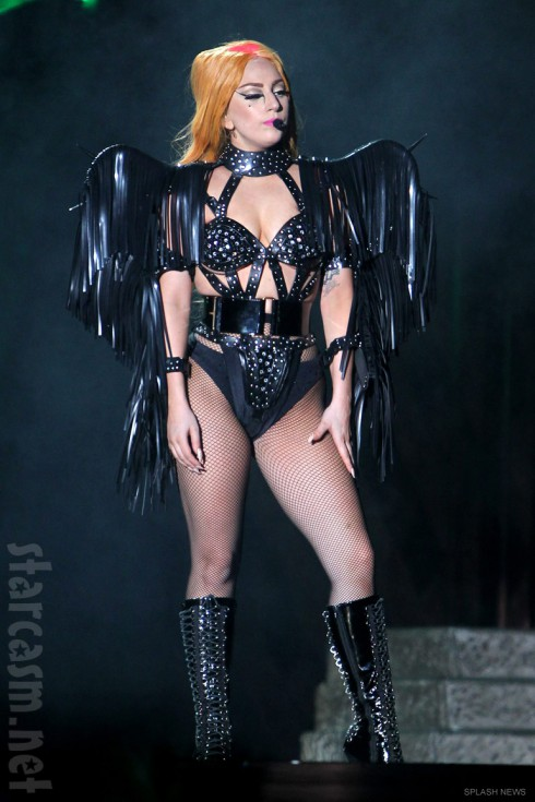 Lady Gaga wears a biker costume with black wings on the Born This Way Ball Tour