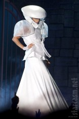 Lady Gaga in a white dress and hat during Born This Way Ball Tour concert in Australia