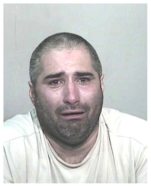 Matthew Fox crying in a fake mug shot photo