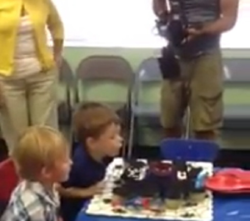 Jace blows out his candles on his third birthday cake