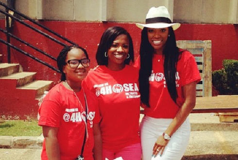 Porsha Williams Stewart and Kandi Burruss do charity work
