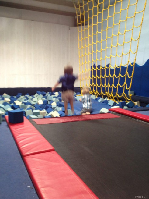Jace Evans jumps in the foam pit at his third birthday party