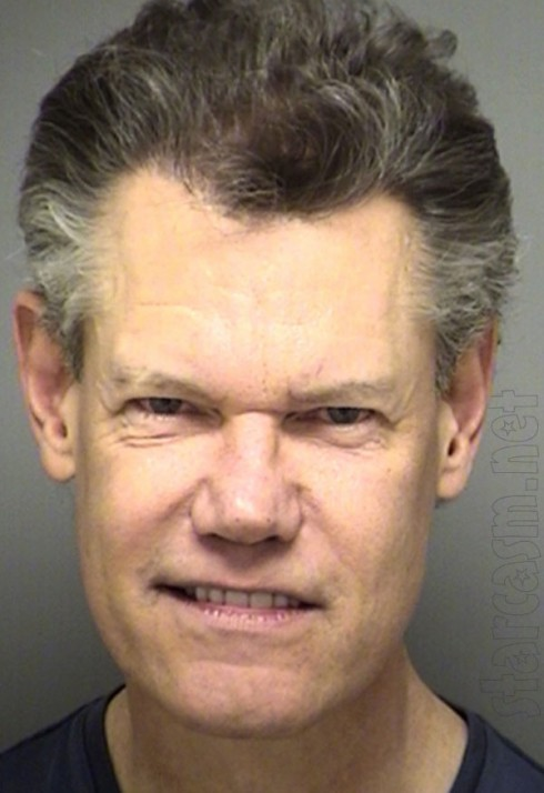 Randy Travis mugshot photo from February 2012 arrest for public intoxication