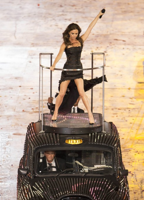 Victoria Beckham performs with the Spice Girls at the Olympics closing ceremony