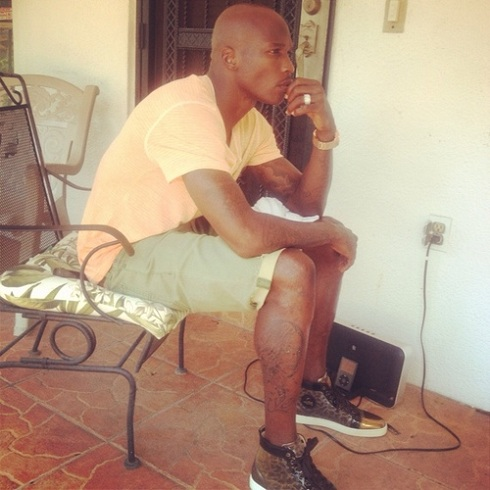 Chad Ochocinco gets Evelyn Lozada's face and name tattooed on his leg
