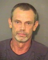 Mug shot of the younger brother of Randy Travis