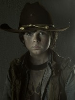 Chandler Riggsas Carl Grimes on The Walking Dead Season 3 photo