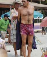 Jon Hamm on the beach chest