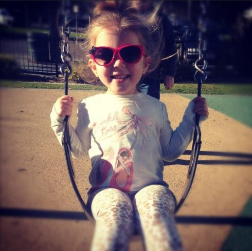 Chelsea Houska's daughter Aubree in a swing in California