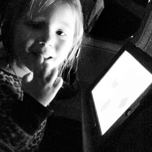 Chelsea's daughter Aubree watching an iPad