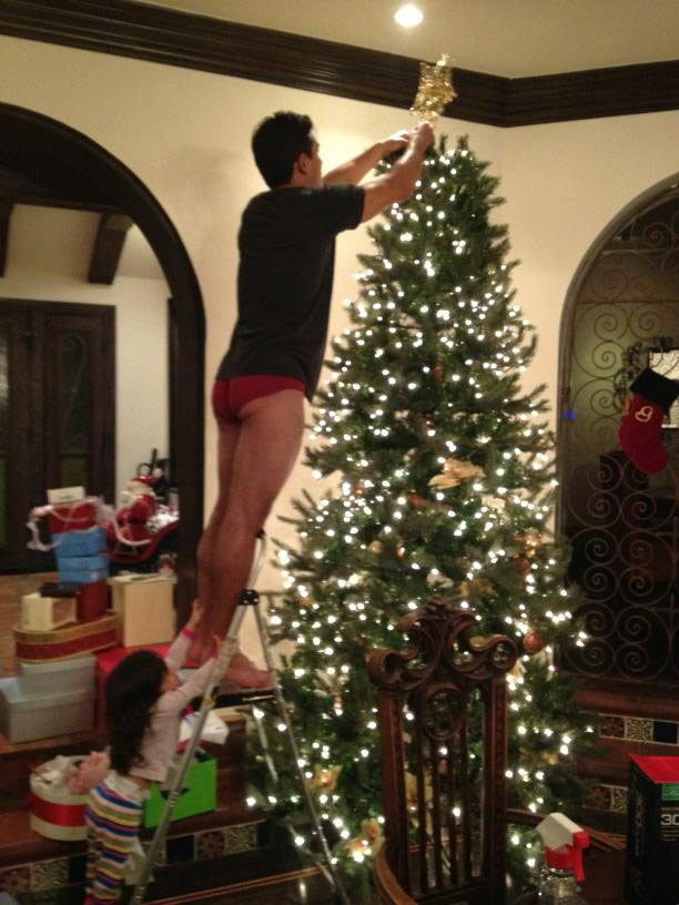 Mario Lopez hangs the Cristmas star in his own designer underwear