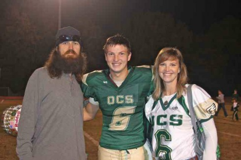 Reed Robertson football parents 490x326 PHOTOS Duck Dynasty Family Album: Jase and Missy Robertson's three children