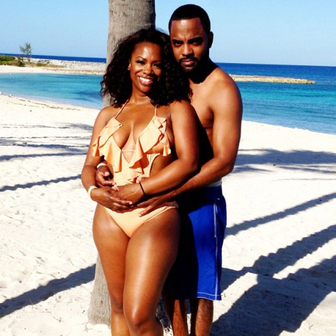 Kandi Burruss and fiance Todd Tucker at the beach in bikini and trunks