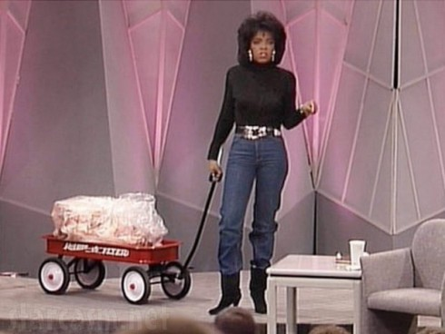 Skinny Oprah Winfrey rolls out a wagon full of fat on her show