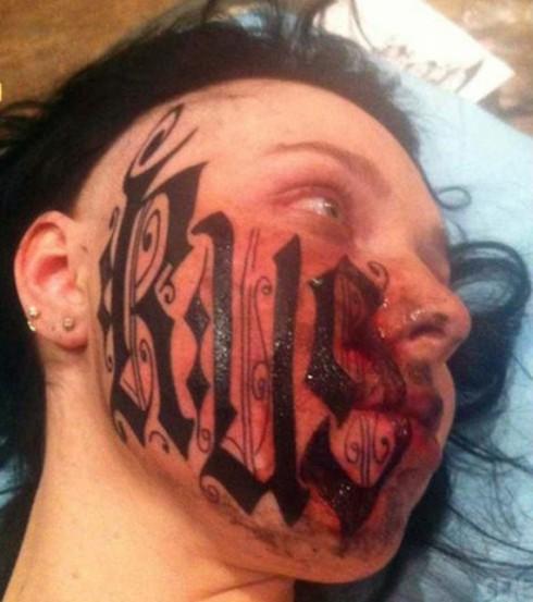 Russian woman Lesya gets face tattoo of boyfriend Rouslan Toumaniantz's name less than 24 hours after meeting him