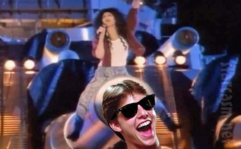 Cher mounts Tom Cruise