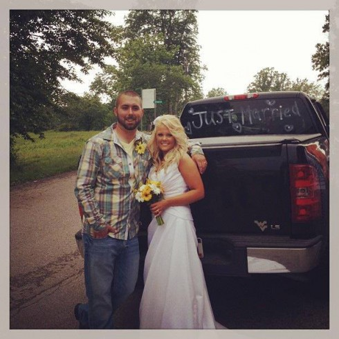 Corey Simms wedding picture in flannel and jeans with Miranda Simms