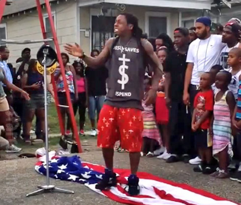 """American flag trampled by Lil Wayne for """"God Bless Amerika"""""""