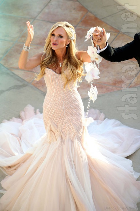 Tamra Barney wedding photo walking down the aisle in her Mark Zunino wedding dress