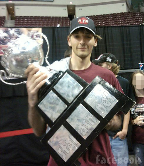 Breaking Amish LA Sam Stoltzfus holding the Calder Cup hockey trophy