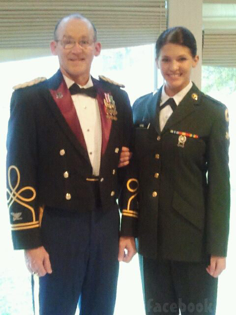 Miss Kansas Theresa Vail in uniform and with dark hair with her dad