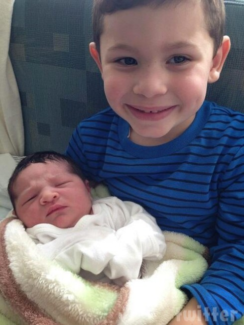 Check out the photo above of Lincoln with big brother Isaac beaming