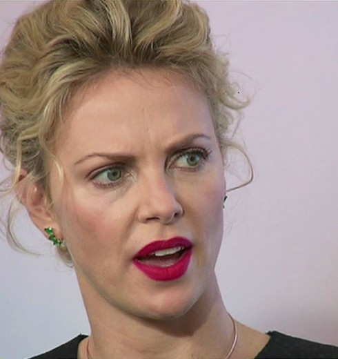 Charlize Theron - Likens Media to Rape