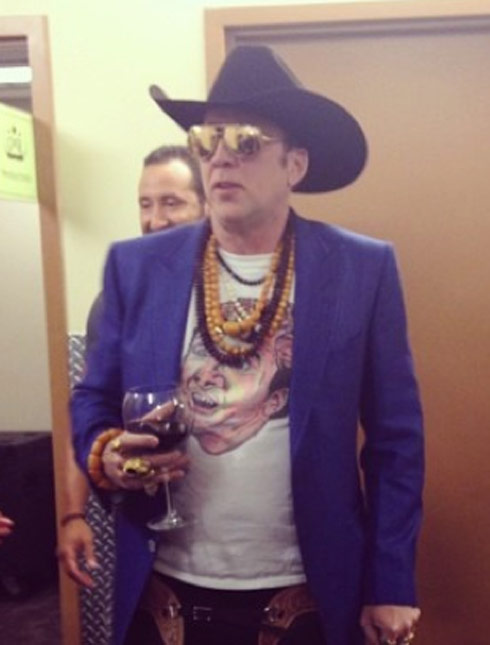 PHOTO Nic Cage wears Nic Cage t-shirt to GN'R concert ...   490 x 645 jpeg 42kB