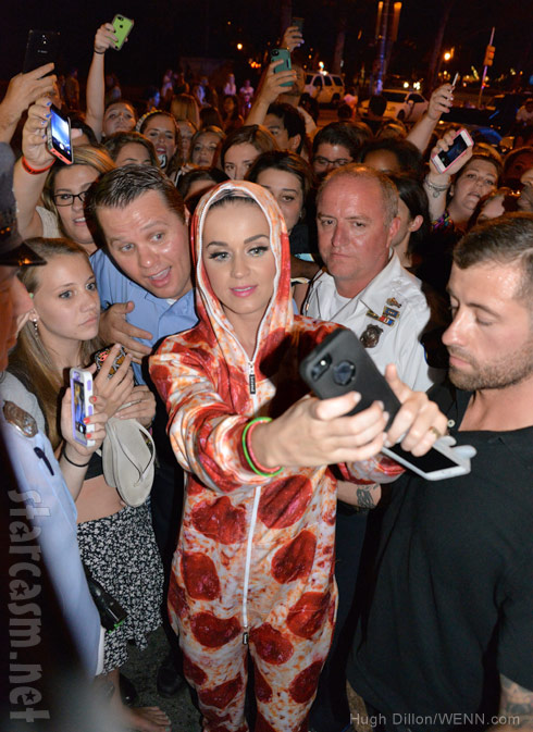 Katy Perry wearing a pepperoni pizza onesie