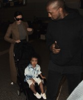 Kim Kardashian, Kanye West and North West at Los Angeles International Airport (LAX)