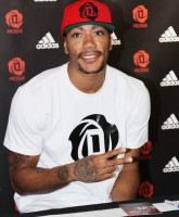 Chicago Bulls player Derrick Rose attends an in-store  Adidas promotional event near  Champs Elysees  Featuring: Derrick Rose Where: Paris, France When: 13 Jul 2013 Credit: WENN.com  **Not available for publication in France, Netherlands, Belgium, Spain, Italy**
