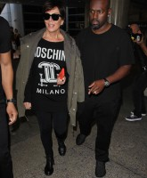 Kris Jenner and Corey Gamble arrive at Los Angeles International Airport (LAX)  Featuring: Kris Jenner, Corey Gamble Where: Los Angeles, California, United States When: 07 Oct 2015 Credit: WENN.com