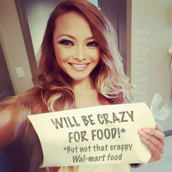Tila Tequila holding sign Will be crazy for food