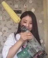 Asian_girl_corn_drill__tn