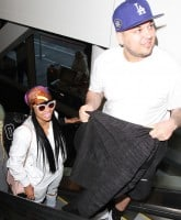 Rob Kardashian and Blac Chyna at Los Angeles International Airport (LAX)  Featuring: Rob Kardashian, Blac Chyna Where: Los Angeles, California, United States When: 25 Mar 2016 Credit: WENN.com