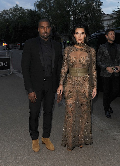 Kim Kardashian and Kanye West leave their hotel and head to the Vogue 100 Gala Dinner, held in Hyde Park