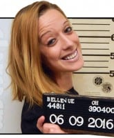 Smiling mug shot lady after McDonald's arrest
