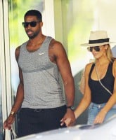 Tristan Thompson holds hands with Khloe Kardashian after shopping at Bal Harbor Shops in Bal Harbor