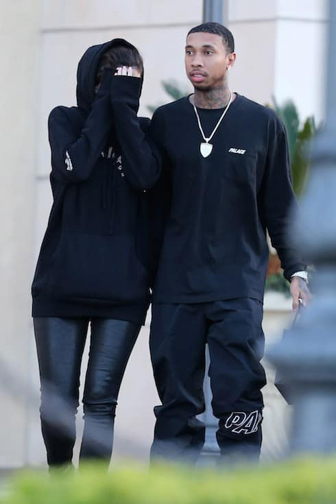 Kylie Jenner covers up with boyfriend Tyga in tow as the couple leave Polachecks Jewellers while Christmas shopping in Calabasas, CA.