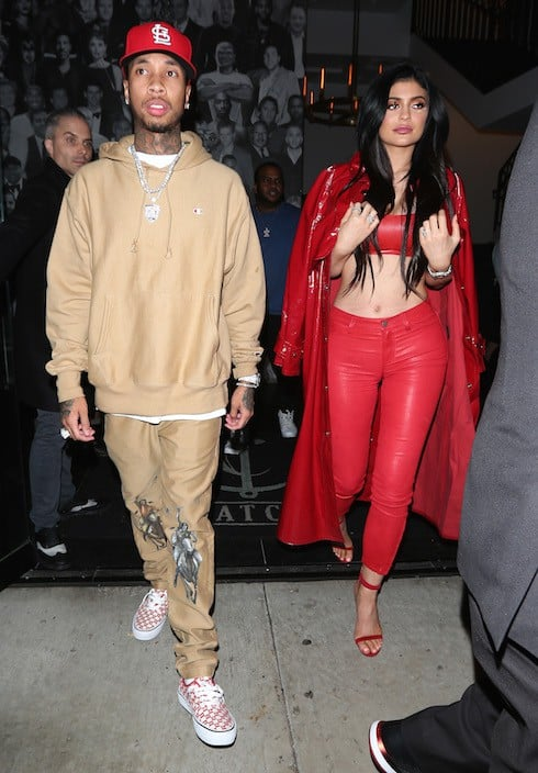 Kylie Jenner shows off her full red attire as she and Tyga dine at Catch restaurant