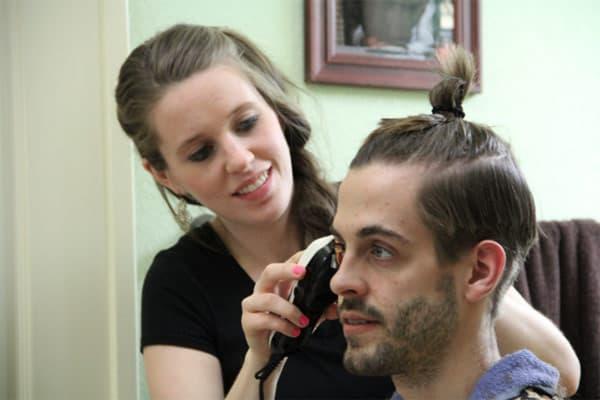 Jill cuts Derick Dillard's hair