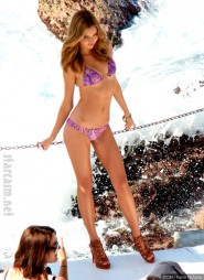 Miranda Kerr in a bikini during a swimwear photo shoot