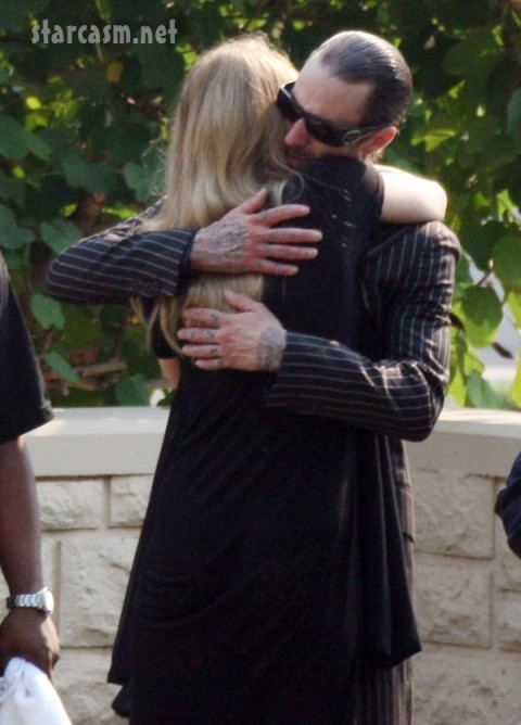 Hayley Wood and Travis Barker hugging at DJ AM's Funeral - Right/Fame Pictures