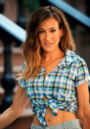 Sarah Jessica Parker in a plaid button up top tied in the front  on the set of Sex and the City 2