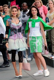 Sarah Jessica Parker as Carrie Bradshaw and Kristin Davis as Charlotte York in a Sex and the City 2 1980s flashback