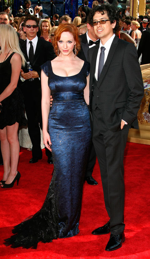 Christina Hendricks and an unknown date arrive on the red carpet at the 2009 61st Annual Primetime Emmy Awards