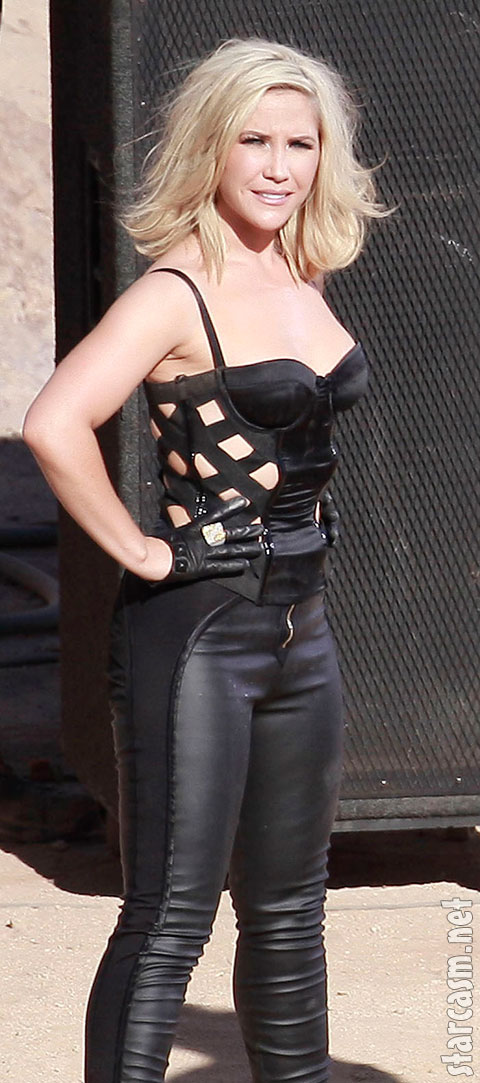 Sugababes member Heidi Range wears a tight leather outfit for a video shoot in the desert