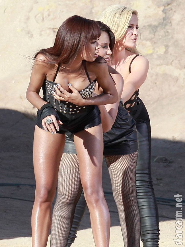 Sugababes Heidi Range Amelle Berrabah and Jade Ewen wear tight leather outfits for a video shoot in the desert