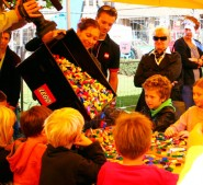 Children help out with the construction of the world's largest Lego tower in Munich Germany
