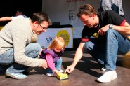 A child helps with the construction of the world's largest Lego tower in Munich Germany